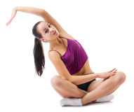 Young sporty woman doing gymnastic exercises Stock Photos