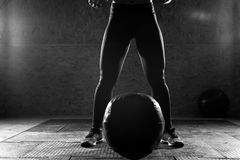 Young sporty woman doing strength workout in gym stock photography
