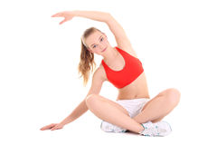 Young sporty woman doing stretching exercise over white backgrou Royalty Free Stock Photos