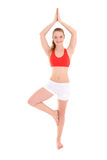Young sporty woman doing yoga Stock Images