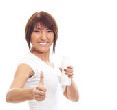 Young sporty woman drinking from the bottle isolated on white Stock Photo