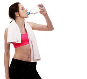 Young sporty woman drinking water Royalty Free Stock Photos