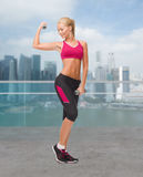 Young sporty woman with dumbbells Stock Images