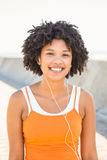 Young sporty woman enjoying music via headphones Royalty Free Stock Photos