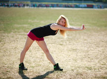 Young sporty woman exercises outdoors Royalty Free Stock Photos