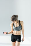 Young sporty woman exercising with dumbbells Royalty Free Stock Photo