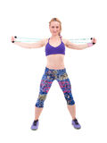Young sporty woman exercising with a resistance rope Royalty Free Stock Photography