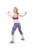 Young sporty woman exercising with a resistance rope Royalty Free Stock Photos