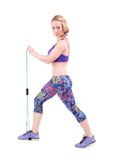 Young sporty woman exercising with a resistance rope Stock Photo