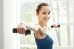 Free Young Sporty Woman Exercising With Dumbbells At Home Royalty Free Stock Image - 150090866