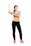 Young sporty woman flexing arm biceps muscle Royalty Free Stock Photo