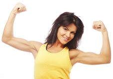Young sporty woman flexing her biceps Stock Image