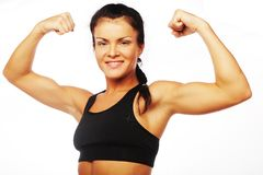 Young sporty woman flexing her biceps Stock Photo