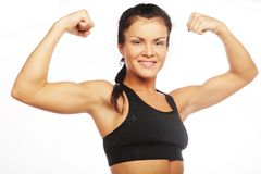 Young sporty woman flexing her biceps Stock Photography