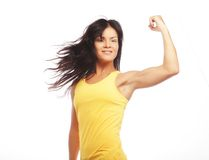 Young sporty woman flexing her biceps Royalty Free Stock Photos