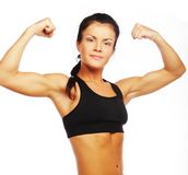Young sporty woman flexing her biceps Stock Photos