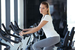 Young sporty woman in gym. Royalty Free Stock Image