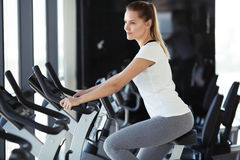 Young sporty woman in gym. Stock Photo