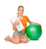 Young sporty woman with gymnastic ball Royalty Free Stock Photography