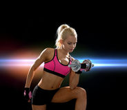 Young sporty woman with heavy steel dumbbell Royalty Free Stock Photo