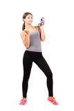 Young sporty woman holding dumb bells beckoning at camera. Full body length portrait isolated over white background royalty free stock photography