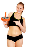 Young and sporty woman holding sport wheel Stock Photography