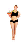 Young and sporty woman holding sport wheel and showing thumb up Royalty Free Stock Images