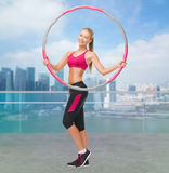 Young sporty woman with hula hoop Royalty Free Stock Photos