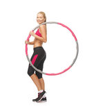 Young sporty woman with hula hoop Stock Images
