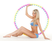 Woman with a hula-hoop. Fitness. Royalty Free Stock Photos