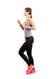 Young sporty woman jogging. Royalty Free Stock Photo
