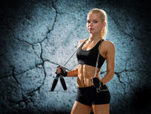 Young sporty woman with jumping rope Stock Photo