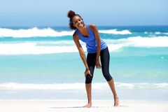 Young sporty woman laughing at the beach Royalty Free Stock Image