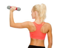 Young sporty woman with light dumbbell Stock Image