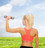 Young sporty woman with light dumbbell Royalty Free Stock Photo