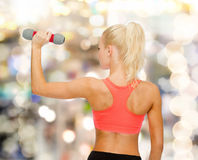 Young sporty woman with light dumbbell Stock Photos