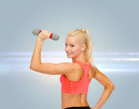 Young sporty woman with light dumbbell Stock Photo
