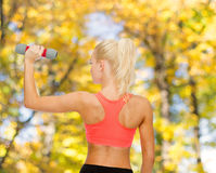 Young sporty woman with light dumbbell Stock Photography