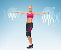 Young sporty woman with light dumbbells Royalty Free Stock Photo