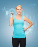 Young sporty woman with light dumbbells Stock Photos