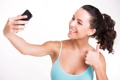 Young sporty woman making selfie Royalty Free Stock Images