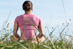 Young sporty woman with pink sportswear, back view Stock Photo