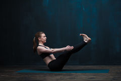 Young sporty woman practicing yoga indoors Royalty Free Stock Photography