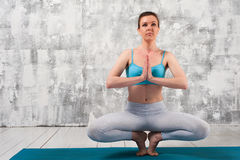 Young sporty woman practicing yoga indoors Stock Photography