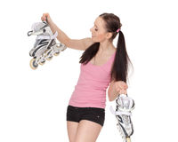 Young  sporty woman with rollerskates. Royalty Free Stock Image