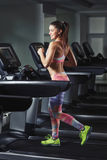 Young sporty woman run on machine in the gym Royalty Free Stock Photos