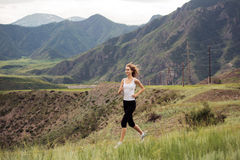 Young Sporty Woman Running Outdoor. Royalty Free Stock Photos