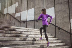 Young sporty woman running Stock Photos