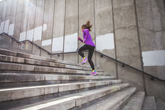 Young sporty woman running stock image