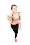 Young sporty woman smiling at camera holding water bottle Stock Images